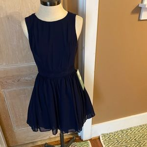 Short navy dress with lace back